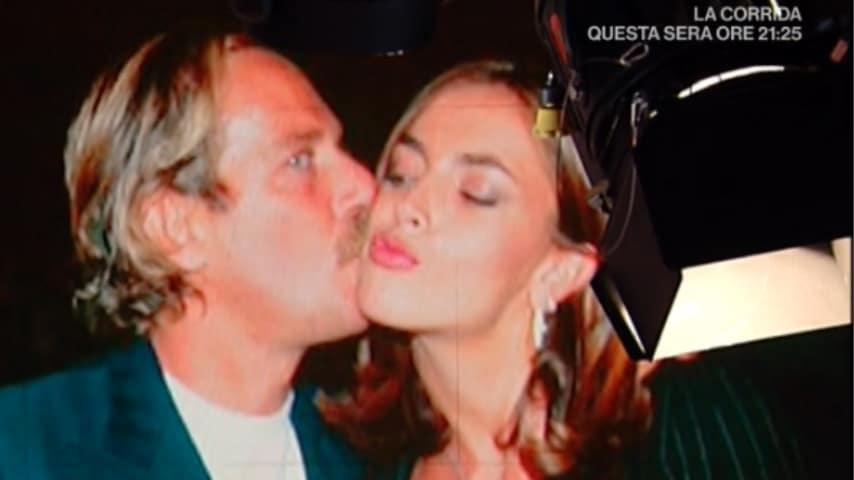 alberto castagna mentre bacia sulla guancia la compagna francesca rettondini
