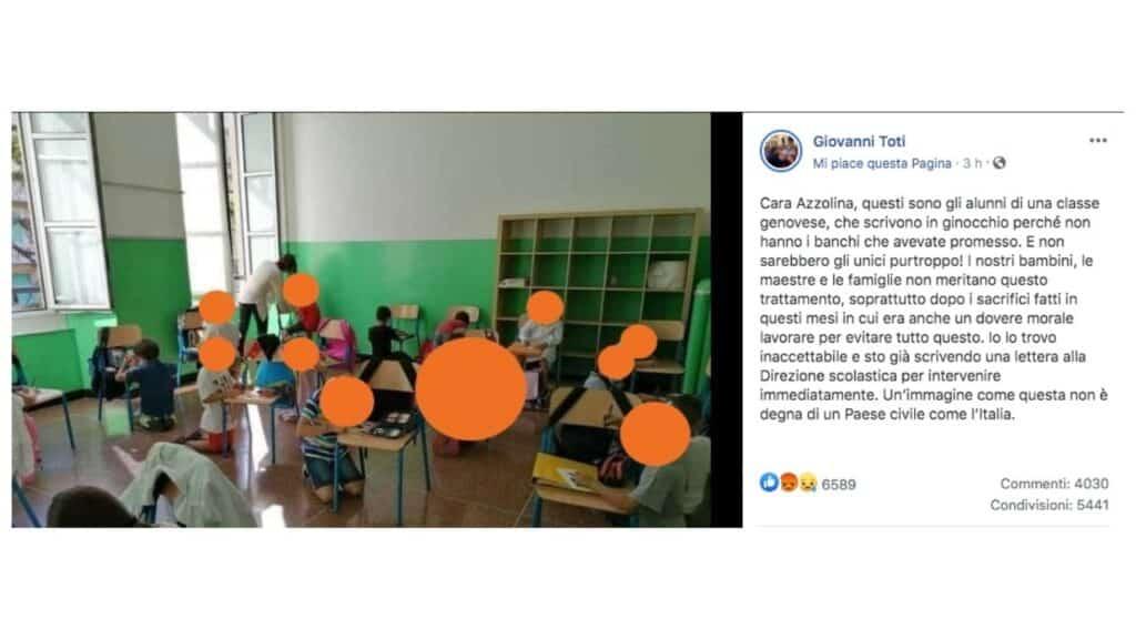 post di giovanni toti con i bambini seduti per terra in classe a genova